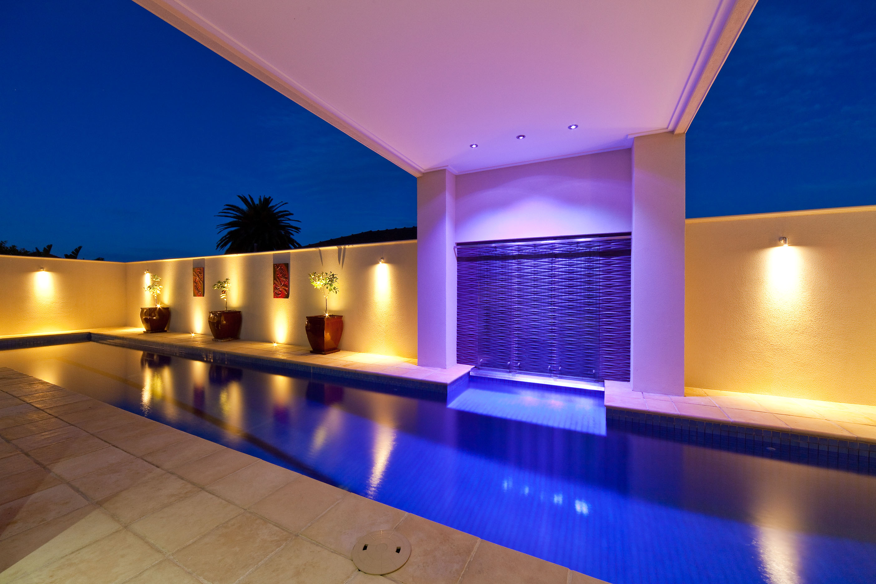 Portico with Outdoor Lighting and Water Feature