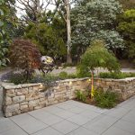 Landscaped Frontyard with Stone Wall and Feature