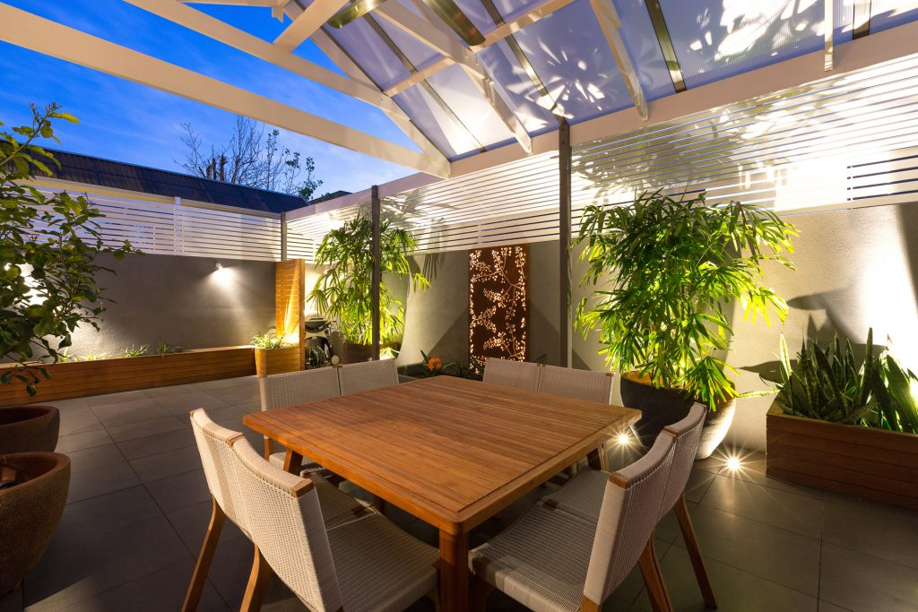 ... Outdoor Living Area With Backlit Screens And Outdoor Lighting
