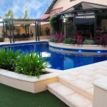 Landscaped Backyard with Pool and Paving