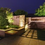 Landscaped Backyard with Hedge and Outdoor Features, Backlit Screen