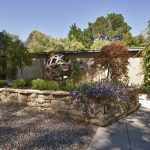 Landscaped Frontyard with Outdoor Lighting and Feature