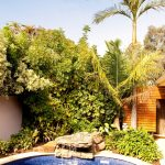 Alfresco Outdoor Room and Kitchen with Landscaped Pool Area