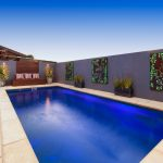 Pool with backlit screen and outdoor lighting