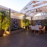 Outdoor Living Area with Backlit Screens and Outdoor Lighting